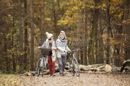 senior couple with bicycles in autumnal