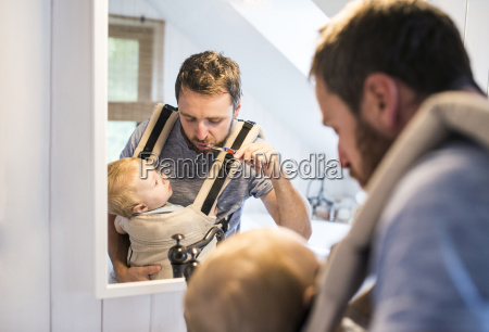 father with baby in baby carrier