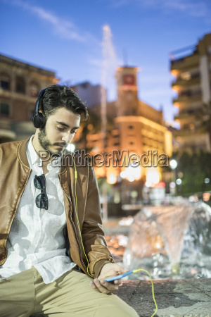 man with headphones and cell phone