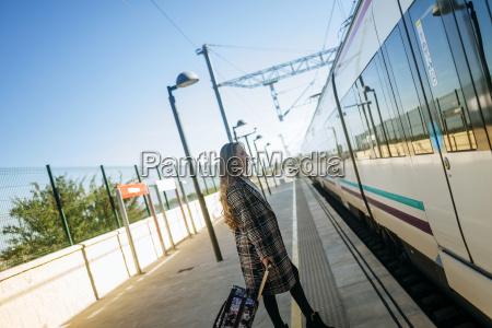 woman walking towards a train car