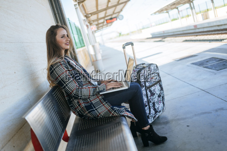 businesswoman sitting on a bench at