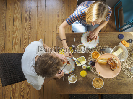 young couple sitting at table having
