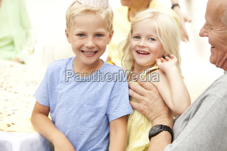 blond boy and girl sitting on