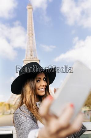 france paris smiling woman taking a