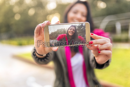 young woman taking a selfie in