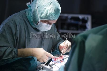 neurosurgeon closing operation wound