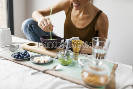 woman preparing matcha latte at home