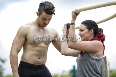 young men and woman doing strength