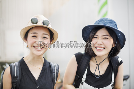 portrait of two smiling young women