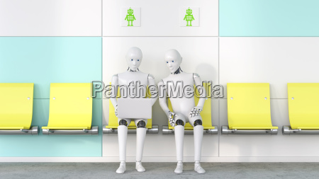 two robots looking at laptop 3d