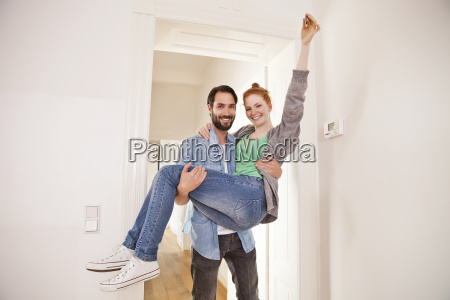 happy couple moving into their new