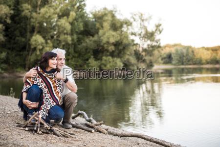 senior couple at campfire at a
