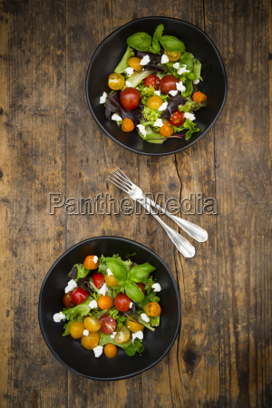 two bowls of leaf salad with