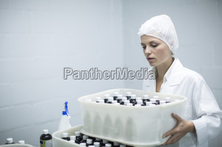 woman carrying box of medical supplies