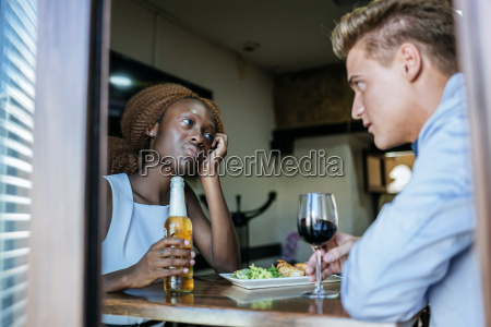 young couple in a bar seen