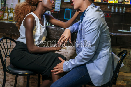 young couple flirting in a bar