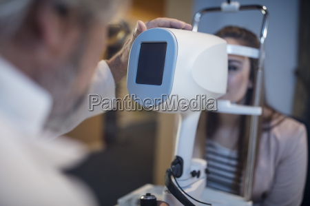 young woman doing eye test at