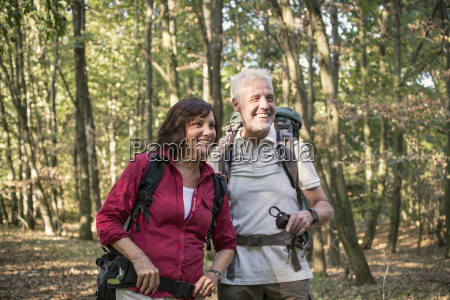 senior couple hiking in a forest
