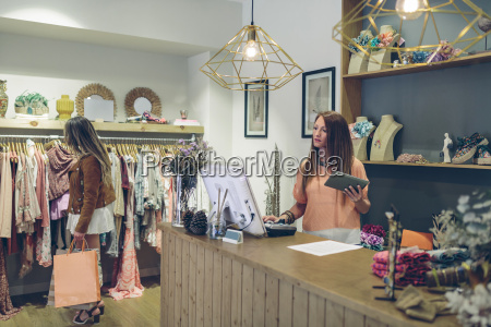 shop assistant at counter in a