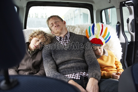 sleeping father sitting in car on