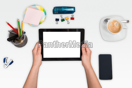 person hand holding digital tablet