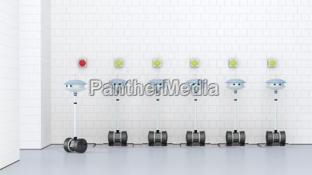 robots recharging at charging station