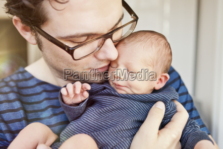 close up of father cuddling his