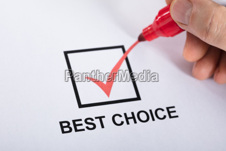 person ticking best choice in check