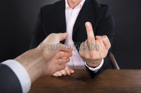 businessman showing middle finger to a