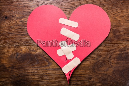 broken heart fixed with bandage
