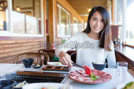 woman having barbecue meat in japanese