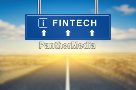 fintech words on blue road sign