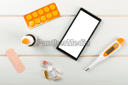 blank smartphone with medical items on