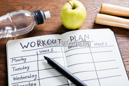 workout plan in notebook