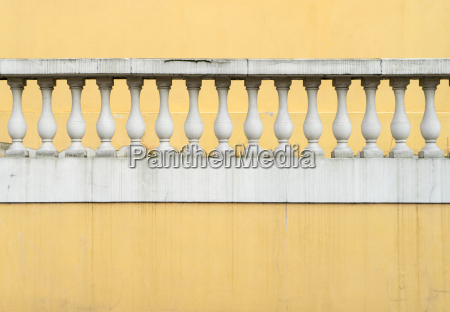 yellow wall with white railing