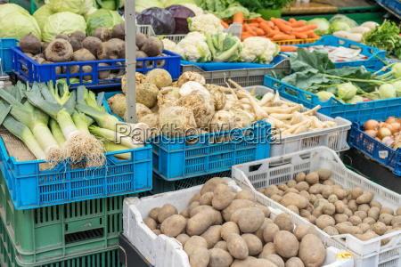 market stand with fresh vegetables