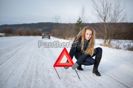 young woman setting up a warning
