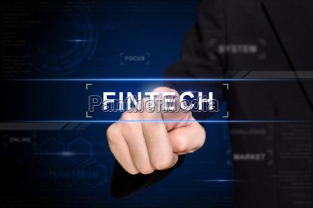 business hand pushing fintech button on