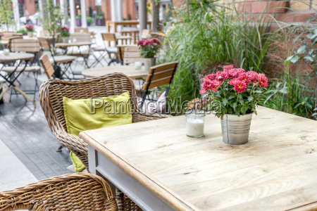 terrace with tables chairs plants and