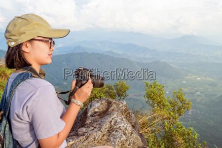 hiker teen girl holding a camera