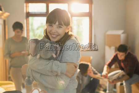 portrait smiling young woman hugging stuffed