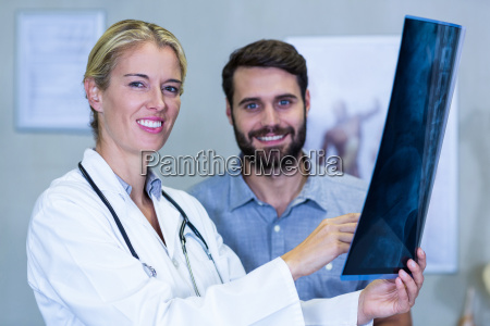 physiotherapist showing x ray to a