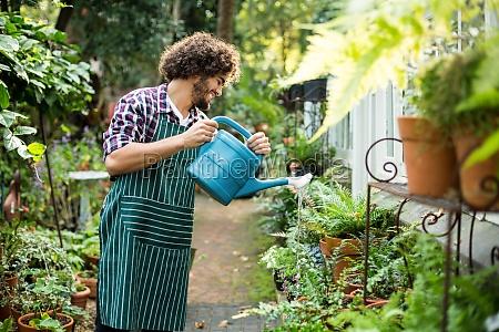 happy gardener watering plants