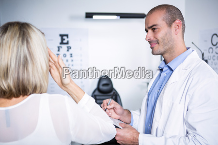male optometrist taking eye test of