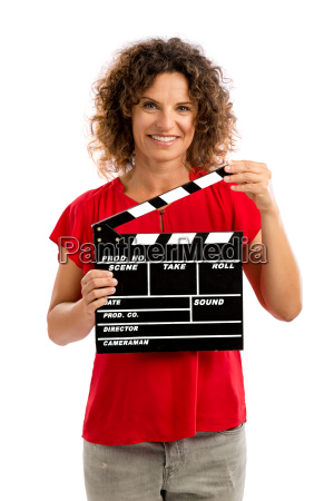 happy mature woman holding a clapboard