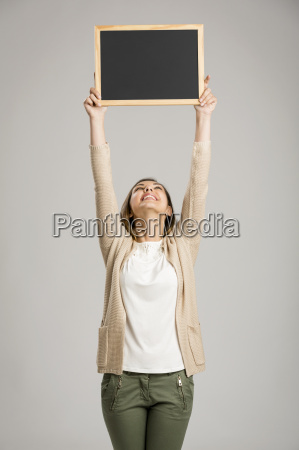 woman showing something on a chalkboard
