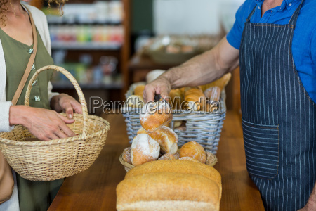 mid section of woman purchasing bread
