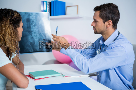 physiotherapist explaining x ray to patient