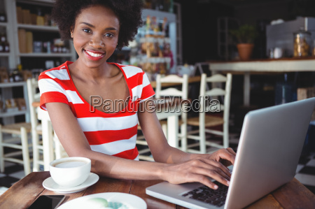 portrait of smiling woman working on