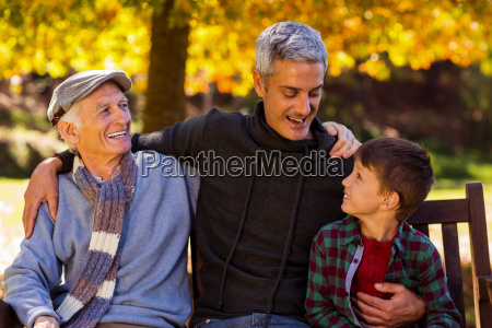 happy man with father and son